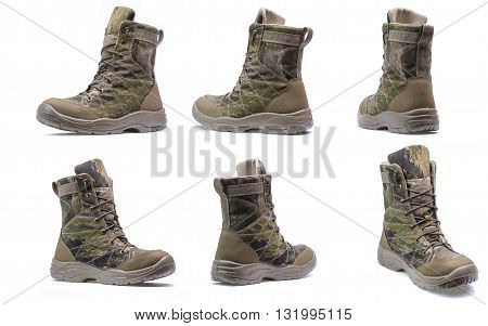New modern army boots with camouflage print isolated on a white background