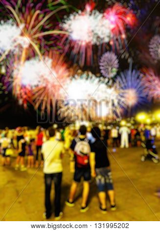 Blurred Scene Of People Looking A With Fireworks