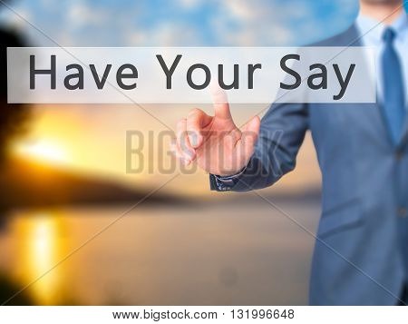Have Your Say - Businessman Hand Pressing Button On Touch Screen Interface.