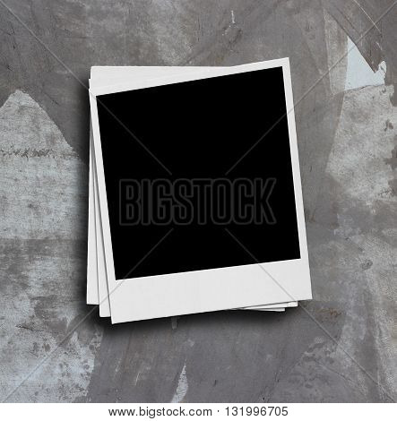 White paper picture frame on the grunge wall