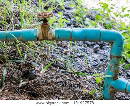 Small pvc pipe with old steel valve for ountryside farm.