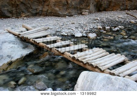 Old Wooden Bridge Over Flowing Stream