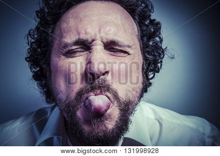derision, man with intense expression, white shirt