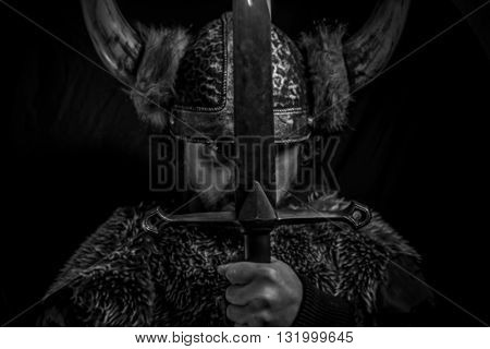 Passion, Viking warrior with iron sword and helmet with horns