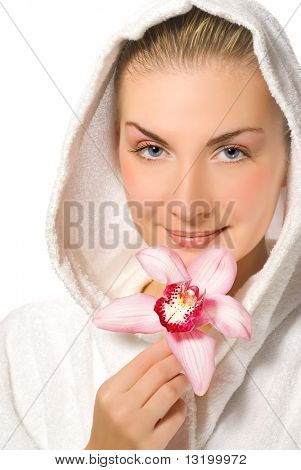 Blond girl holding pink orchid in her hands