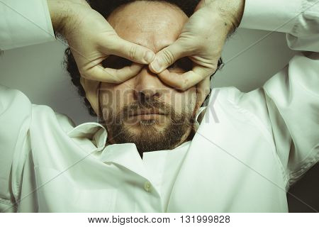 imagination and madness, man with intense expression, white shirt