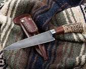 foto of gaucho  - argentine gaucho knife punal criollo style photographed on blanket - JPG
