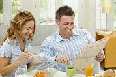 picture of young women  - Couple having healthy breakfast at home - JPG