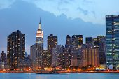 pic of gleaning  - Cityscape of Midtown Manhattan across the Hudson River at night - JPG
