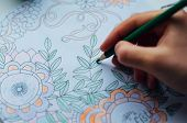Постер, плакат: Image Of Woman Coloring Adult Coloring Book Trend For Stress R