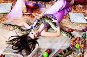 pic of concubine  - Shot of an oriental woman posing with a python - JPG