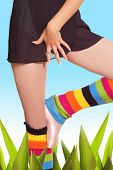 Girl's legs in colorful gaiters