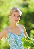 stock photo of blonde woman  - Beautiful blond girl relaxing outdoors - JPG