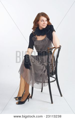 Pretty woman on chair