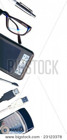 Mobile office: pda, phone, pen and usb cables isolated on white with clipping path