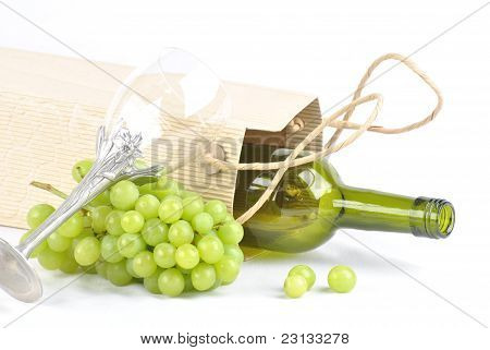Empty wine bottle with green grappe.