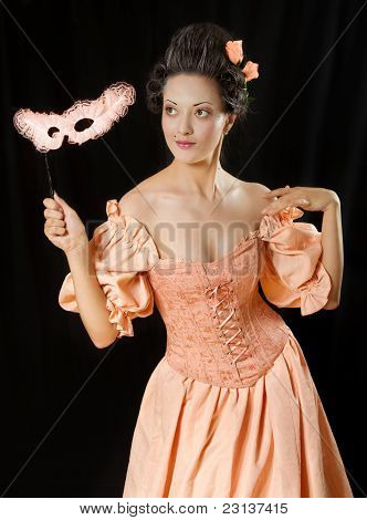 Stylized Rococo Portrait Of Woman In Historical Costume With Crinoline And Mask. Low Key