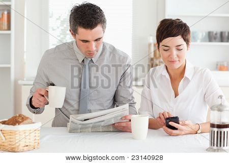 Cute Couple Preparing For Work At Breakfast