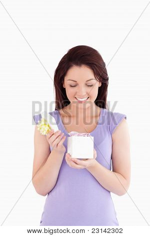 Joyful Woman Opening A Box