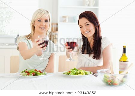 Women Toasting With Wine