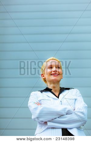 Smiling Business Woman With Crossed Arms Standing Near Office Building