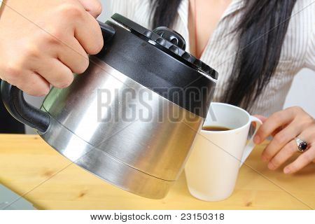 Hand Puring Coffee To A Business Woman
