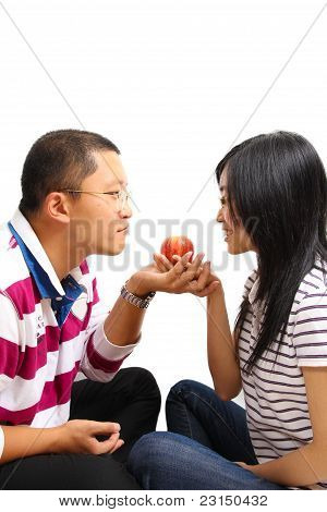 Young Chinese Couple Sharing An Apple