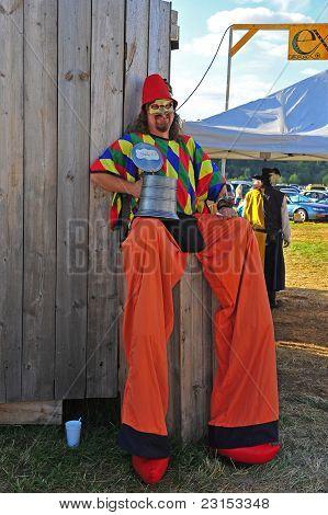 Man on stilts takes a break