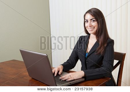Happy businesswoman ready to work