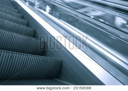 gray steps of modern escalator stairway