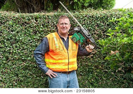 Man Trimming Vines