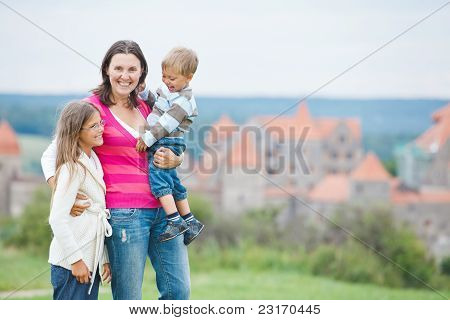 Travelers. Young mother with her two children