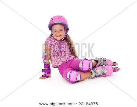 Happy little girl with roller skates and protective gear resting - isolated