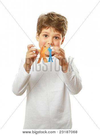 Little happy child holding paper people -  united culturally diverse population concept