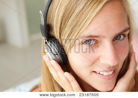 Teenage girl wearing headphones