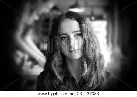 poster of Thoughtful Beautiful Girl Sitting In A Cafe. She Has Big Brown Romantic Eyes. With Nice Brown Long H