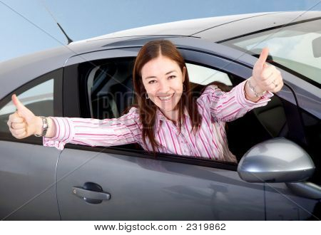 Woman Happy With Her New Car