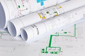 stock photo of air conditioning  - Detail of architects drawings with three rolled drawings on one flat one - JPG
