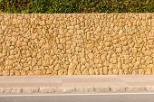 Street Background With Masonry Wall Of Stones Ans Pavement poster