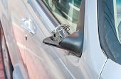Damaged Car. Broken And Damaged Side Mirror On The Car Doors With Remaining Wires poster