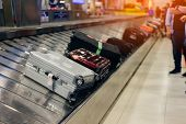 Suitcase Or Luggage With Conveyor Belt In The Airport. poster