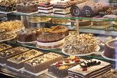 Different Types Of Cakes In Pastry Shop Glass Display, Showcase With Sweets Cakes, Pastries, Biscuit poster