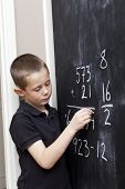 Young Boy In Front Of The Blackboard