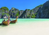 Famous Scenic Maya Bay Beach At Ko Phi Phi Leh Island With Two Traditional Longtail Taxi Boats Moori poster