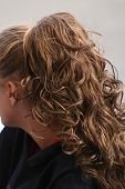 stock photo of teen pony tail  - cascading brunette ponytail - JPG