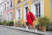 Sexy Woman Jump On Street Of Paris, France, Vacation. Woman In Sunglasses, Red Dress, Sneakers On St poster