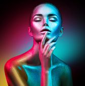 High Fashion model woman in colorful bright sparkles and neon lights posing in studio, portrait of b poster