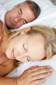 foto of portrait middle-aged man  - Head and shoulders mid age couple sleeping - JPG
