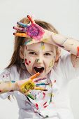 Little girl making funny faces. Funny kid. Colorful body makeup. poster