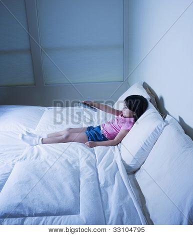 Hispanic girl watching television